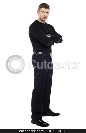 Handsome young bodyguard, full length portrait stock photo, Handsome young bodyguard, full length portrait. Arms folded by Ishay Botbol