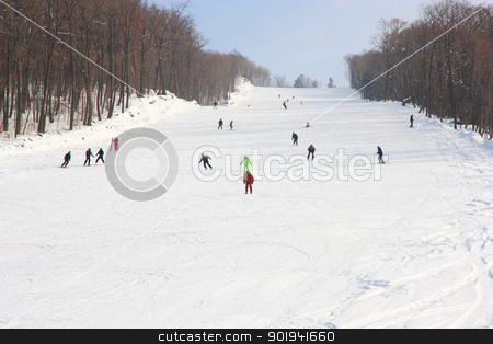 Skiers go on the lift on mountain in Primorski Territory Russia stock photo, Skiers go on the lift on mountain in Primorski Territory Russia by aarrows
