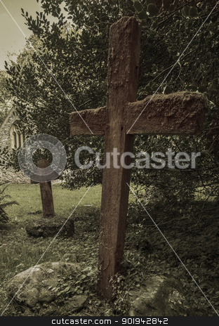 Old Wooden Cross Grave Markers stock photo, Old wooden cross grave markers in an ancient graveyard. by Trevor Jordan