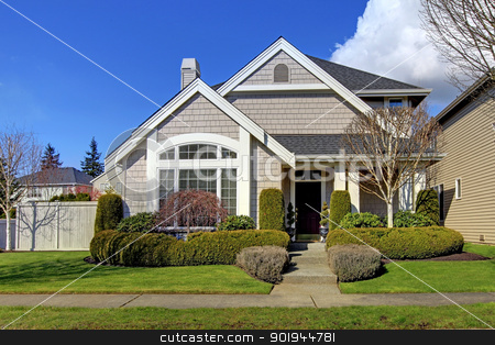 Classic new American house exterior in the spring. stock photo, Classic new beige American house exterior in the spring. by iriana88w