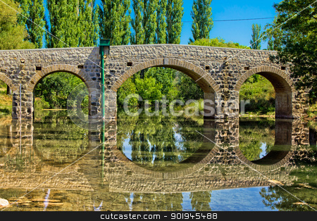 Stone bridge over Zrmanja river stock photo, Stone bridge over Zrmanja river in Kastel Zegarski, Dalmatia, Croatia by xbrchx