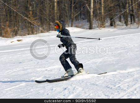 Young woman skiing stock photo, The young girl on skis goes from mountain in a spotty suit by aarrows