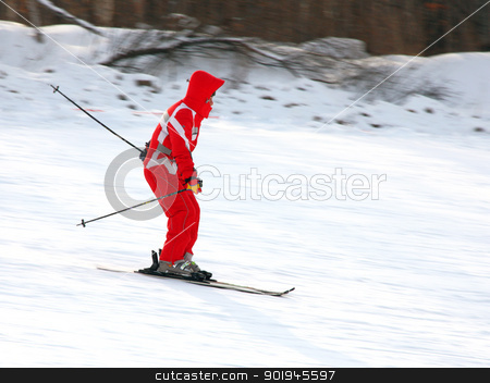 attractive young woman skiing stock photo,  attractive young woman skiing quickly goes from mountain in winter equipment by aarrows