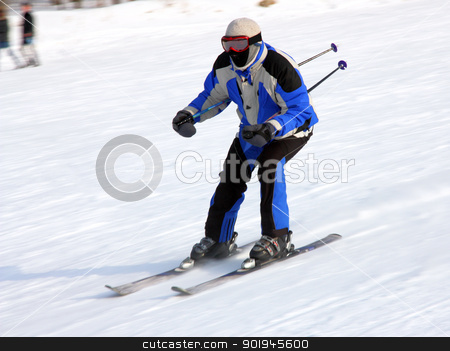 The skier quickly goes from mountain stock photo, The skier quickly goes from mountain in winter equipment