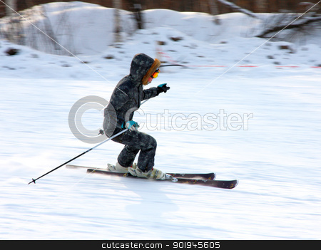 The young girl on skis  stock photo, The young girl on skis goes from mountain in a spotty suit by aarrows