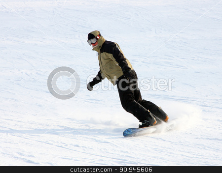 Snowboarder in a suit going from mountain  stock photo, Snowboarder in a yellow suit going from mountain on against wood by aarrows