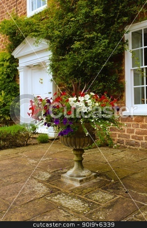 Flower Urn stock photo, A stone flower urn with an attractive summer floral display outside an English country house. by Trevor Jordan
