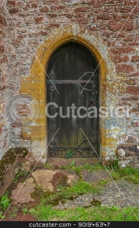 Church Tower Side Entrance stock photo, The side door to the church tower. Probably used in older times as a quick way in and out by the local vicar. by Trevor Jordan