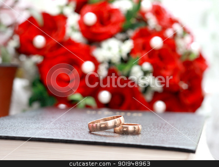 gold rings  stock photo, gold rings on the Bible. Bridal bouquet as a background by Oleksandr Pakhay