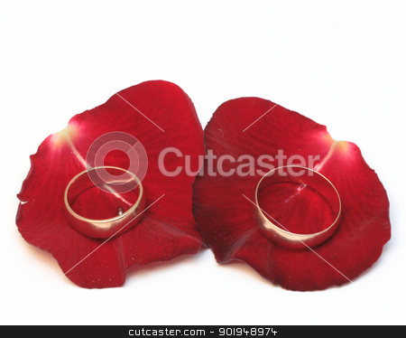 wedding rings stock photo, Golden wedding rings over red rose by Oleksandr Pakhay