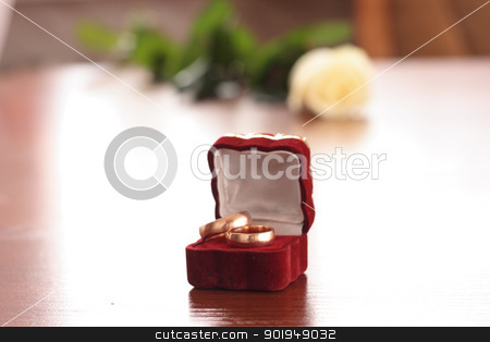 rings and rose stock photo, on table 2 golden rings and rose by Oleksandr Pakhay