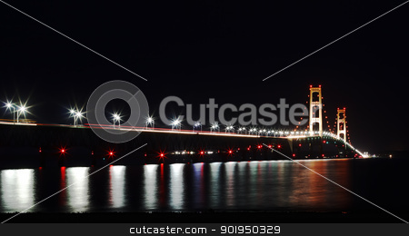 Mackinac Bridge at Night stock photo, The Mackinac Bridge is located on Interstate 75 in northern Michigan at the Straits of Mackinac. The bridge connects Michigan's upper and lower peninsulas.  by Delmas Lehman