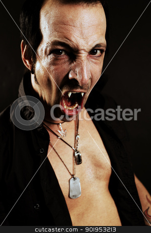 Fierce vampire stock photo, Photo of a male vampire with mouth open and fangs showing.  Harsh lighting and heavily filtered for scarier feel. by &copy; Ron Sumners