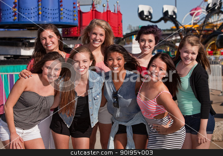 Friends at an Amusement Park stock photo, Group of 8 happy female teens at an amusement park by Scott Griessel