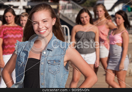 Confident Girl with Jealous Friends stock photo, Confident young Caucasian girl in front of jealous friends by Scott Griessel