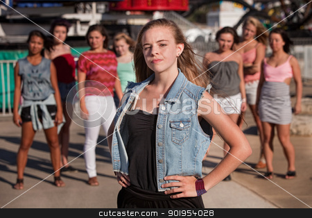 Blond Teen With Serious Attitude stock photo, Young blond girl with a confident attitude in front of friends by Scott Griessel