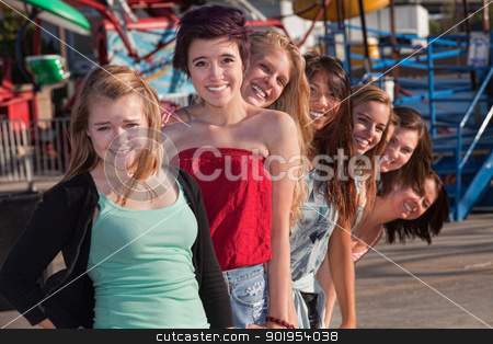Teens Standing Behind Each Other stock photo, Smiling group of teenage girls standing behind each other by Scott Griessel