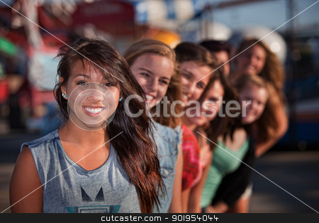 Row of Cute Girls at Theme Park stock photo, Mixed row of eight smiling girls outside together by Scott Griessel