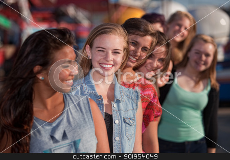Smiling Teen Girls in Line stock photo, Smiling teenage girls standing behind each other in line by Scott Griessel