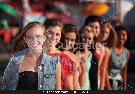 Group of Girls Smiling stock photo, Group of eight girlfriends in a row smiling by Scott Griessel