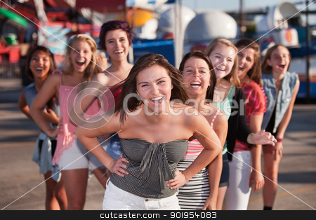 Eight Girls Laughing stock photo, Group of 8 girls laughing together at a theme park by Scott Griessel