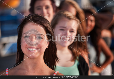 Happy Teenage Girls in a Row stock photo, Row of happy smiling female teenagers outdoors by Scott Griessel