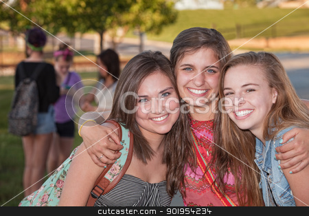 Three Hugging Friends stock photo, Three pretty teenage girls hugging at student campus by Scott Griessel