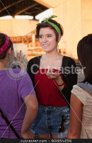 Excited Girl Talking stock photo, Excited Mexican teenage girl with friends outdoors by Scott Griessel