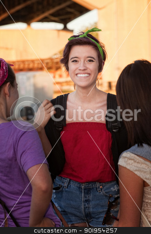 Overjoyed Young Teen with Friends stock photo, Flattered teenage girl talking with friends outdoors by Scott Griessel