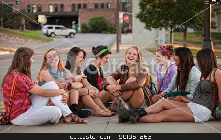 Eight Pretty Girls Sitting Outdoors stock photo, Eight pretty young mixed group of teenagers outdoors by Scott Griessel
