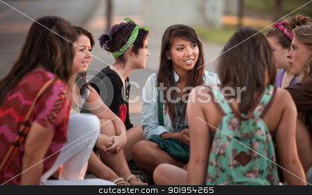 Female Students Talking Outdoors stock photo, Female students talking outdoors on the sidewalk by Scott Griessel