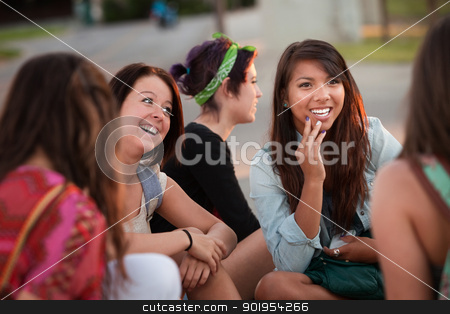Fascinated Asian Teen with Friends stock photo, Interested female teenager in conversation with friends by Scott Griessel