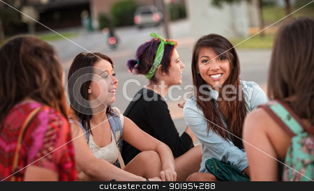 Diverse Group of Teenage Girls Talking stock photo, Diverse group of happy teenage girls sitting and talking by Scott Griessel