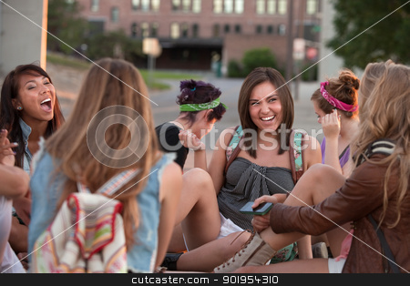 Female Students Laughing Together stock photo, Group of female students sitting outside laughing together by Scott Griessel