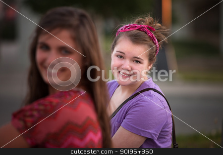 Grinning Young Woman in Purple stock photo, Young female in purple with friend outdoors by Scott Griessel
