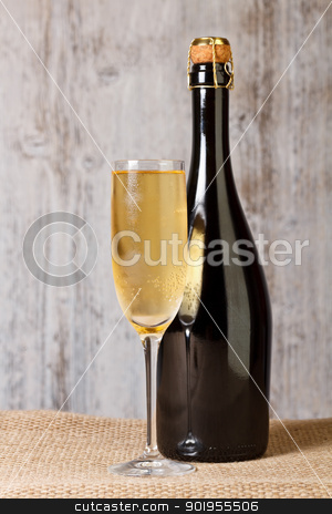 Champagne  stock photo, Bottle and glass of champagne  by Grafvision
