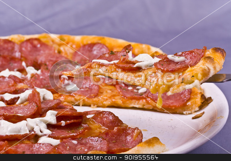 pizza stock photo, Extreme close-up view of a section of a pizza by Grafvision