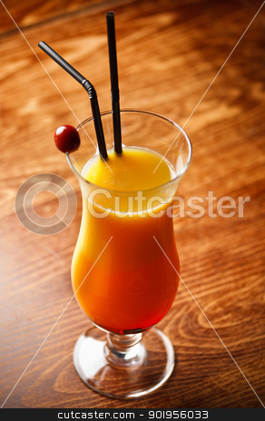 Cocktail with orange Juice  stock photo, Cocktail with orange Juice on bar tabel, cherry decoration by Grafvision