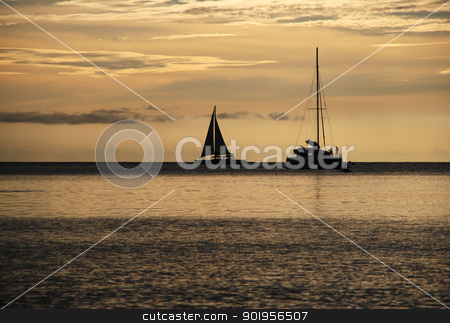 Sailing at sunset stock photo, Sailing boat and catamaran on the horizon as the sun goes down by Sarah Marchant