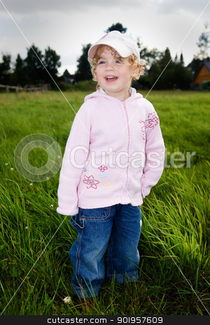 Farmers child stock photo, Very young girl standing in a meadow by Picturehunter