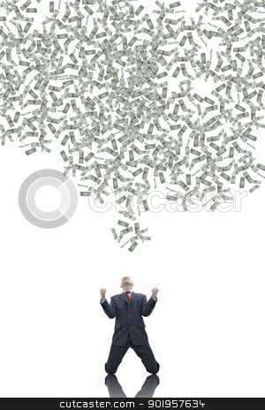 Success stock photo, Young businessman with a lot of falling dollars by Picturehunter