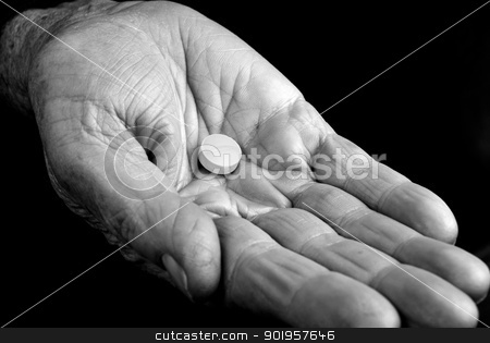 Old hand with pill stock photo, Hand from an old woman with a pill inside by Picturehunter