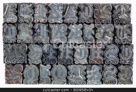 decorative metal letterpress type stock photo, random alphabet letters in decorative metal letterpress type - initials font - stained by color inks by Marek Uliasz
