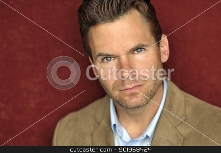 Handsome serious business man stock photo, Headshot of handsome business man with serious look on face by Chad Zuber