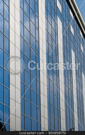 Modern office building stock photo, Blue sky reflected in the windows of office building by nvelichko