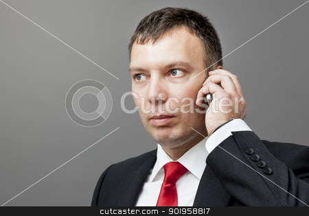 businessman on mobile phone stock photo, An image of a businessman on a mobile phone by Markus Gann