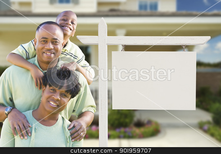 African American Family In Front of Blank Real Estate Sign and H stock photo, African American Family In Front of Blank Real Estate Sign and New House. by Andy Dean