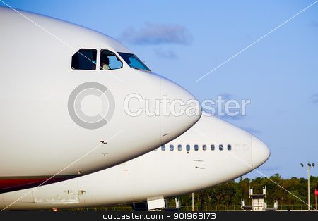Plane in airport stock photo, Air travel - Parked planes in an airport by Lars Christensen