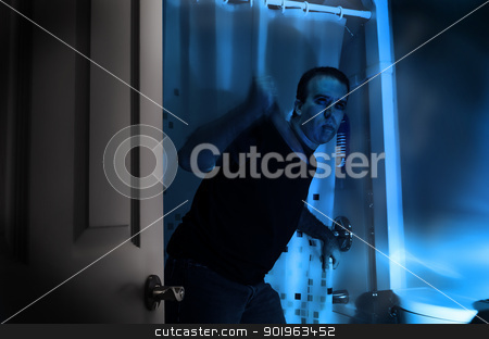 Bathroom Murder stock photo, A halloween killer is sneaking around in a bathroom, about to murder someone in the shower. by Richard Nelson