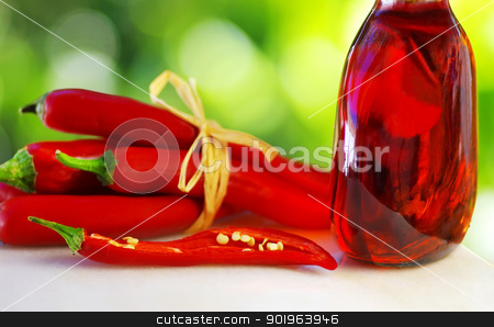 Red chili and rose wine stock photo, Red chili and rose wine by Inacio Pires